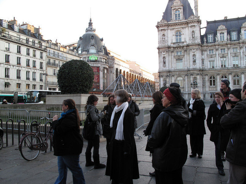 Exiting the Metro on Rue de Rivoli with Hótel de Ville and BHV department store in the background