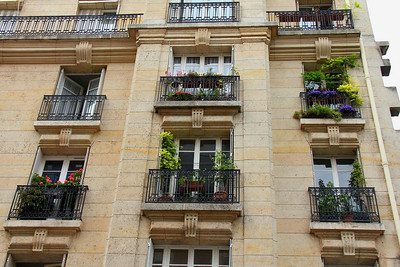 The weather in the summer makes it easy to decorate your balcony as these Parisians have done.