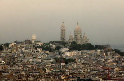 The Sacre Coeur Cathedral in the hillside Montmartre District of Paris, as seen from the Eiffel Tower in a light rain. It is about 5 miles away.