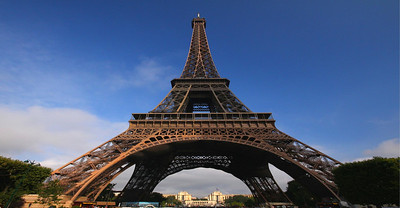 The lattice design of the Eiffel Tower is quite strong, and is one of the most efficient shapes in architecture. Though it is 1053 feet high, the Tower only weighs 7300 tons. If you melted down the tower and spread it over the area of its base it would only be 2.36 inches high. Puddled iron, a special, high quality, long-lasting iron was used in the framing. It will likely be there as long as France wants it be. The Tower's deflection rates due to wind and the sun's heat are very small for such a structure.