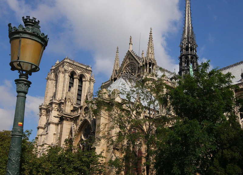Notre Dame. The trademark flying buttresses (not easily seen in this photo) serve double duty as structural supports for the vaulted ceiling and as roof drain pipes.