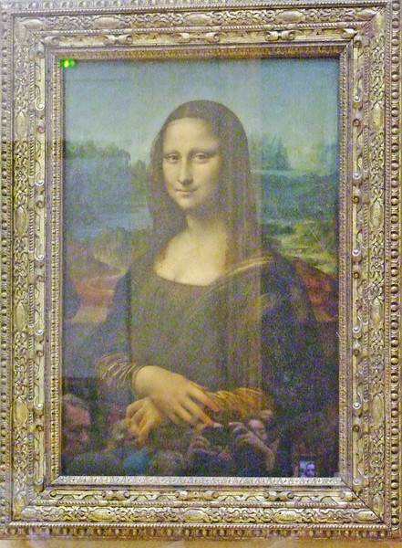 The Mona Lisa by Leonardo da Vinci.  He brought a few paintings with him from Italy when the King invited him to live in France.  The Mona Lisa was one of those and thus it resides in France and not Italy.