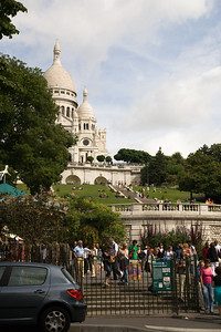 A first glance a Sacre Coeur.  One irritation is all the tourists.  The joke is that in August there are no Parisians in Paris; these are all tourists -- lots of French people from other places; Germans; Brits; etc...