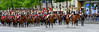 The French mounted guard chasseurs on the Champs-Elysees (large boulevard in Paris) that leads up to the Arc de Triomphe.