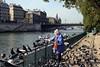 Bird lady on Seine riverbank