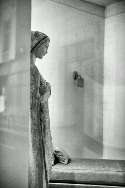 Parisian Window Statue