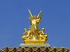 Atop the front of the Opera Garnier.