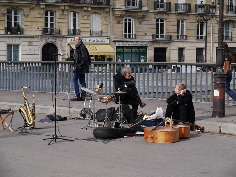 Musicians on break near Notre Dame.