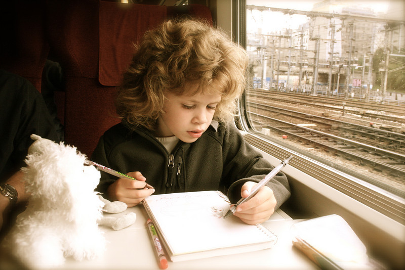 Keeping busy on the train.