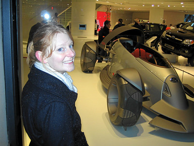 Cheesy grin for the camera in front of the Toyota concept car display on the Champs-Élysées.