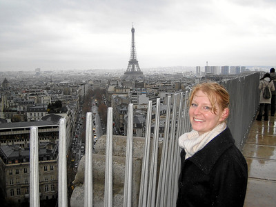 Admiring the Eiffel tower from the top of the Arc de Triomphe.