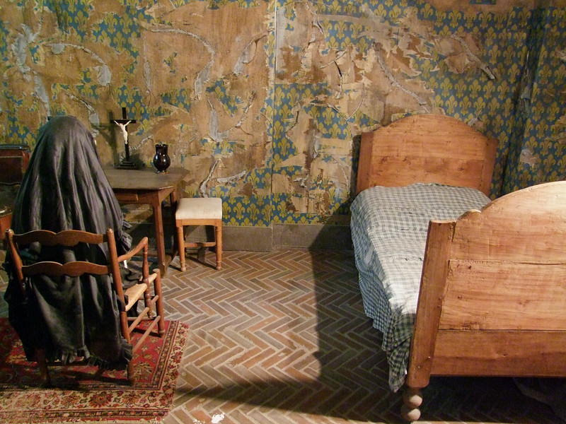 "The prison bedroom of Marie-Antoinette who was executed by the guillotine during the French Revolution.  History has it that when the hungry French people said they had no bread she said, ""Let them eat cake""."