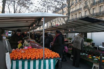 A Paris street market selling a little bit of everything.
