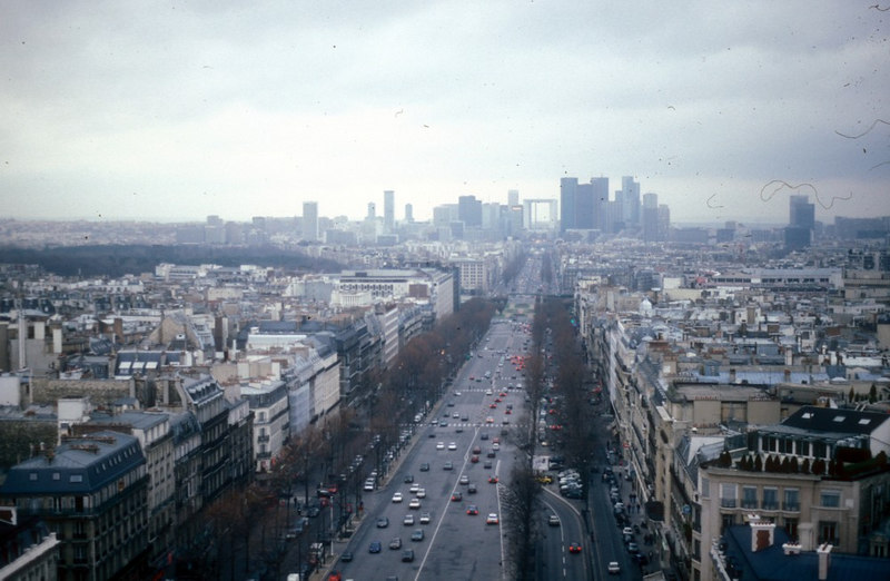 View north west from the Arc de Triomphe towards La Defence, the business district of Paris (begun in 1955) with its modern architecture and arch