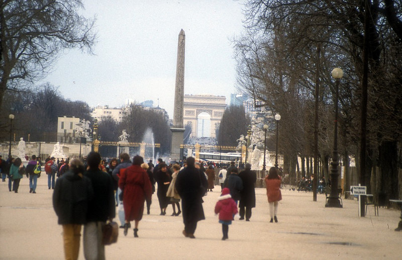 A favourite strolling place for Parisians and visitors from around the world, the Tuilleries Garden - seen here at its West Gate with the Egyptian obelisk (donated to Louis Phillipe by Mehmet Ali in 1831) in the Place de la Concorde in the middle background. Behind it at the far end of the long Avenue de Champs Elysees is the Arc de Triomphe.