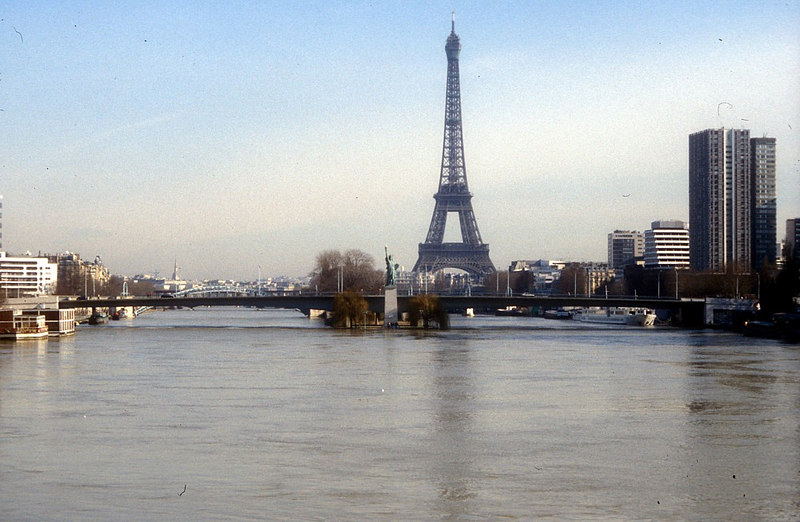 View up the River Seine with the Eiffel Tower in the 7th Arrondissement on the Left Bank (the right as viewed).