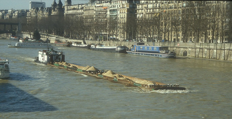 A bulk cargo on the Seine - barges and pusher tug.