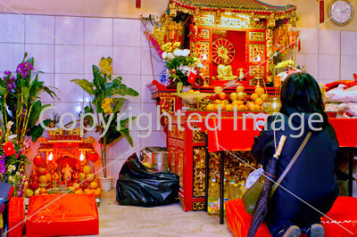 Paris, France, Woman Praying in Buddhist Temple in Chinatown,  Ave . De l'Ivry, 75013.