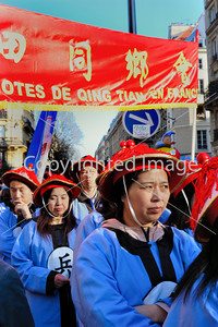 Paris, France, Street Scene, French-Chinese Woman Parading in Chinese new year Carnival in Street in the Marais Area.