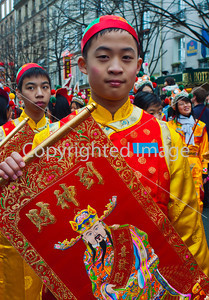 Paris, France, Street Scene, French-Chinese in Traditional Costumes Parading in Chinese new years Carnival in Street in the Marais Area.