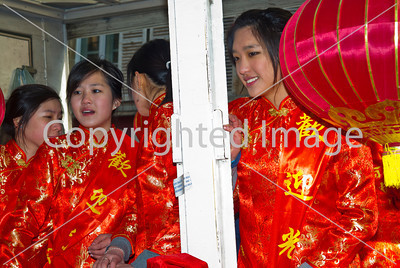Paris, France, Chinese Women in Traditional Dress, Parading in Chinese new year Carnival in Street in the Marais Area.