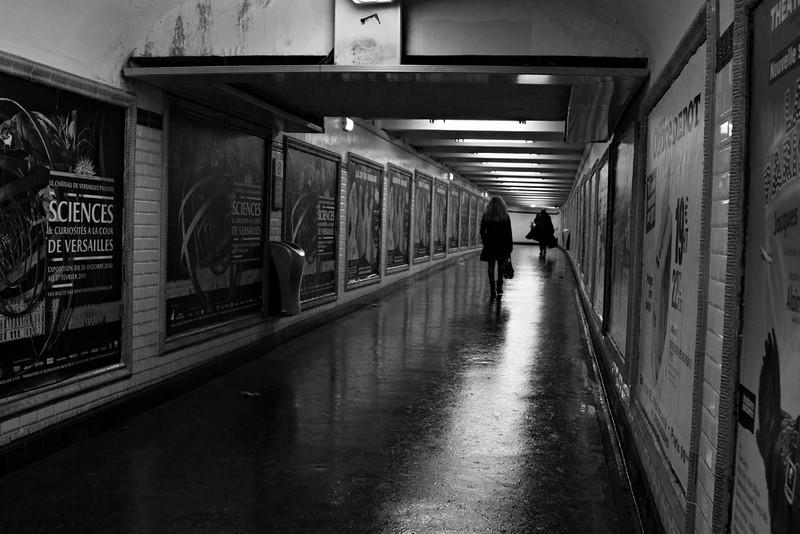 along the corridor of the metro in Paris