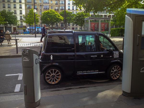 Paris, France, Electric Car charging Plug in on Street