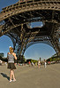PARIS, France  - Young Female Teen Photographing the Eiffel Tower, Summertime, View from Below with Fish-eye- Lens