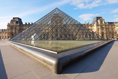 Triangle Architecture Now an unmistakeable piece of art, the Louvre Museum Pyramid and its' fountains and pools still makes for artistic photographs.  I am amazed by the architect's creative vision.