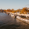 view of big wheel and houseboats from across the Seine, Paris