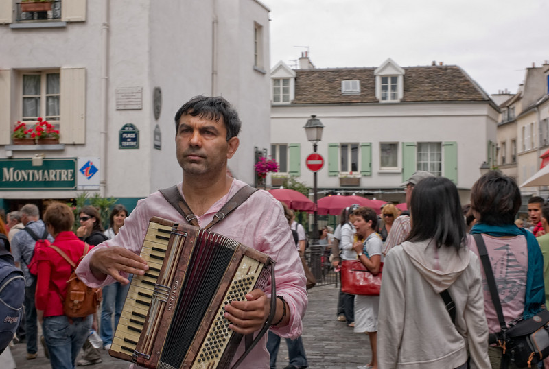 A wandering accordian player, walking the streets of Montmartre.