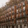 brick apartment building in Paris