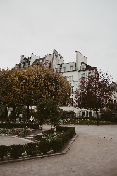 small park and parisian building in the background