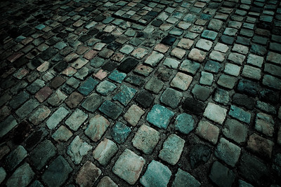 Some of the cobble stone walkway in the courtyard of the Louvre.