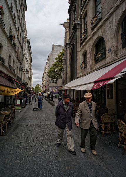Two old men, out for a morning walk on the back streets of Paris.