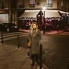 woman walking around paris at night