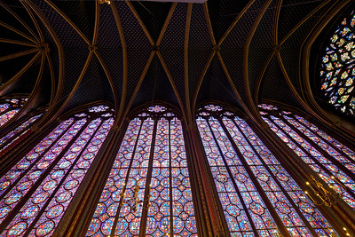 Saint Chapelle Stained Glass Wall is literally about the size of a football field.  The glass tells thousands of religious stories and was made so beautiful because they wanted it to represent heaven.