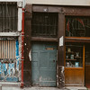 worn down store fronts in Paris