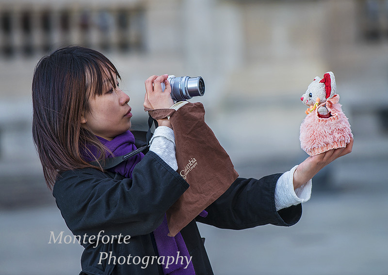 Kristen Kwong taking pictures of stuffed animal at the Louvre in Paris France.