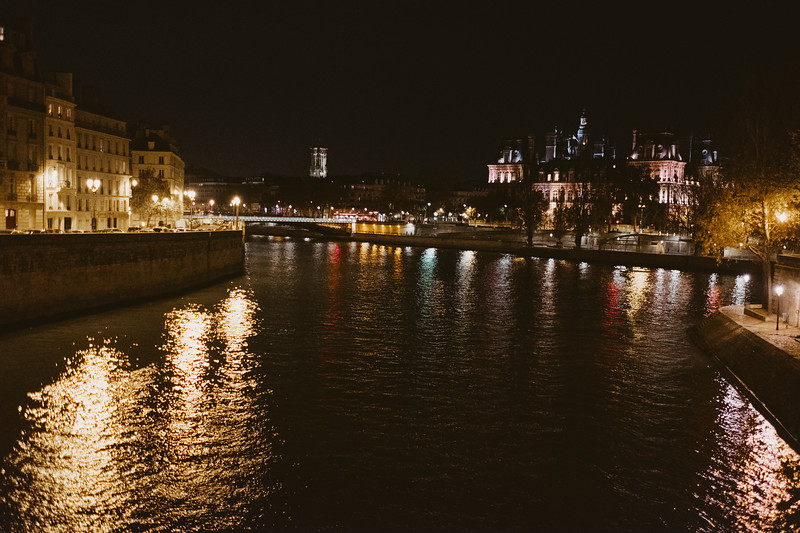 Paris river seine at night with reflection of lights