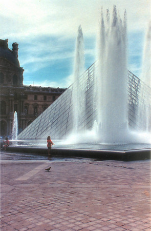 Lan by the Pei pyramid fountain Le Louvre Paris France - Jul 1996