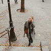 woman walking up stairs in montmartre