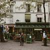woman walking through montmartre