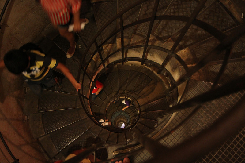 Very long stair case to the bottom of the Arc de Triomphe.