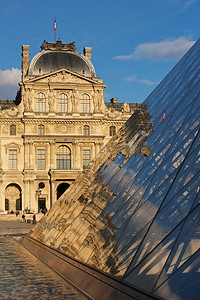 Louvre Late Afternoon with a small slice of the castle, pyramid and reflecting pool.  I tried to show the French flag in the glass reflection.