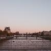 love locks on bridge in Paris at sunset