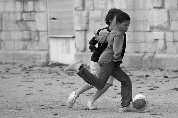 Football against a Wall