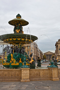Fountain in Place de la Concorde with La Madeleine in the background