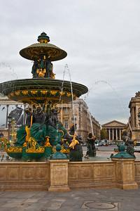 Fountain in Place de la Concorde with La Madeleine in the background