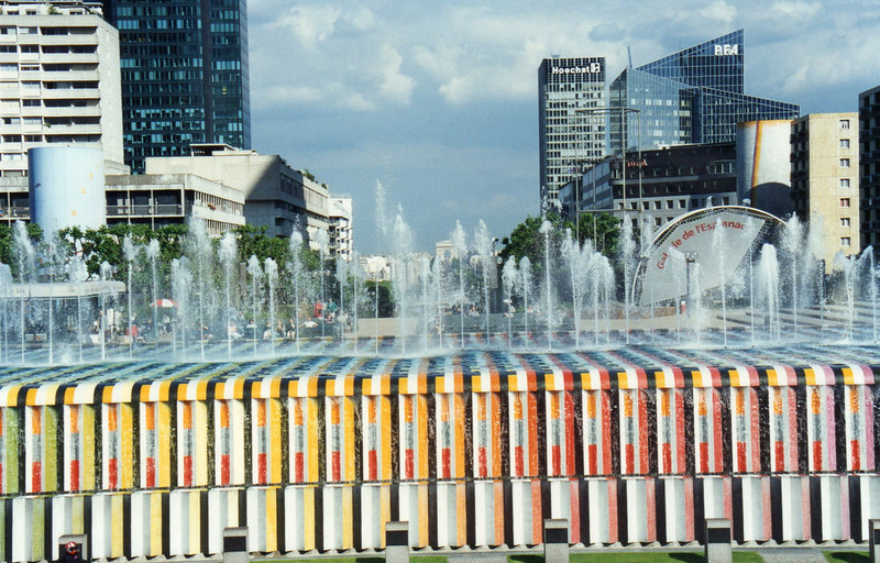 Fountains at La Defense. The Arc de Triomphe is seen in the center of the fountain and is perhaps 2 miles away.